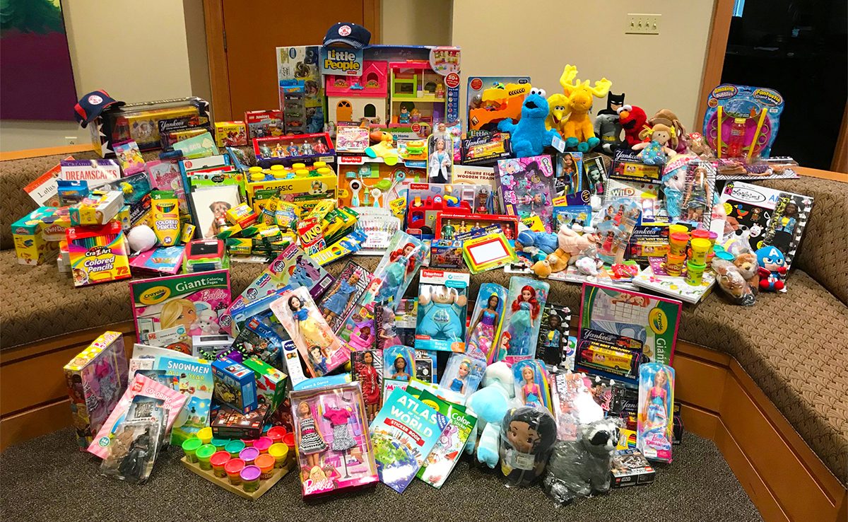Group photo of many toys donated